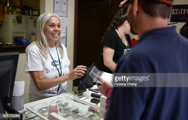 Lorraine Cendejas of Botana Care left helps customers purchasing recreational marijuana Northglenn Colorado May 16 2014