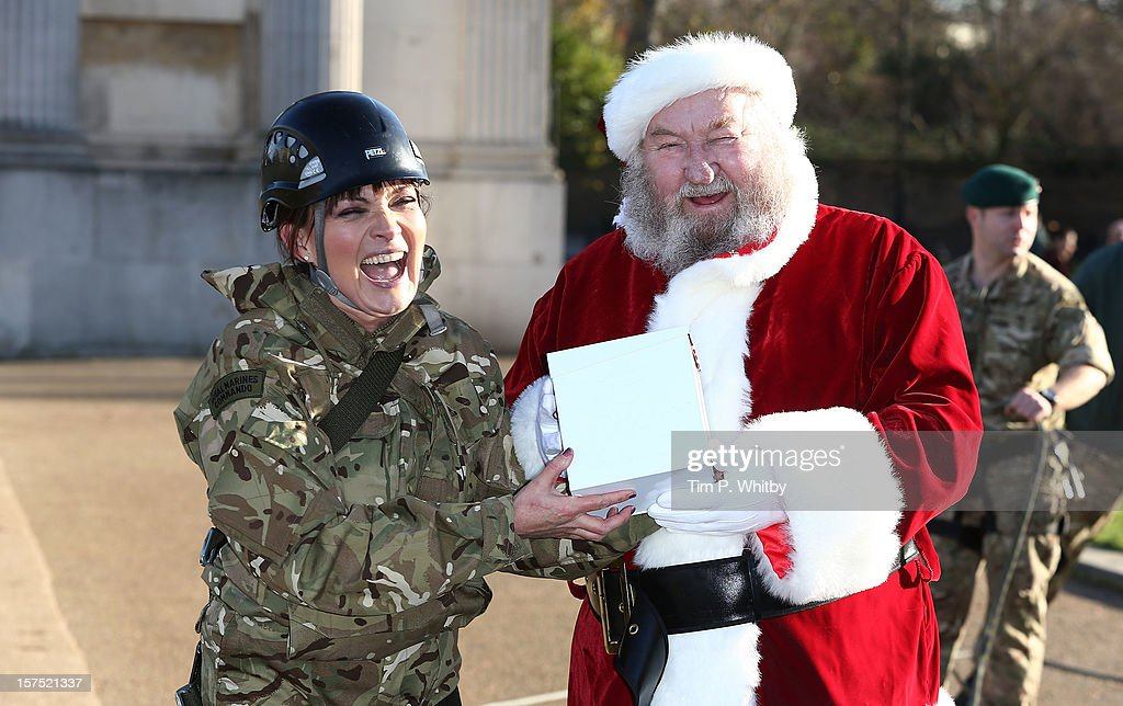 Lorraine Kelly poses with Father Christmas after she zip wired down Wellington Arch to launch the 2012 UK4U Christmas Box appeal at Wellington Arch...
