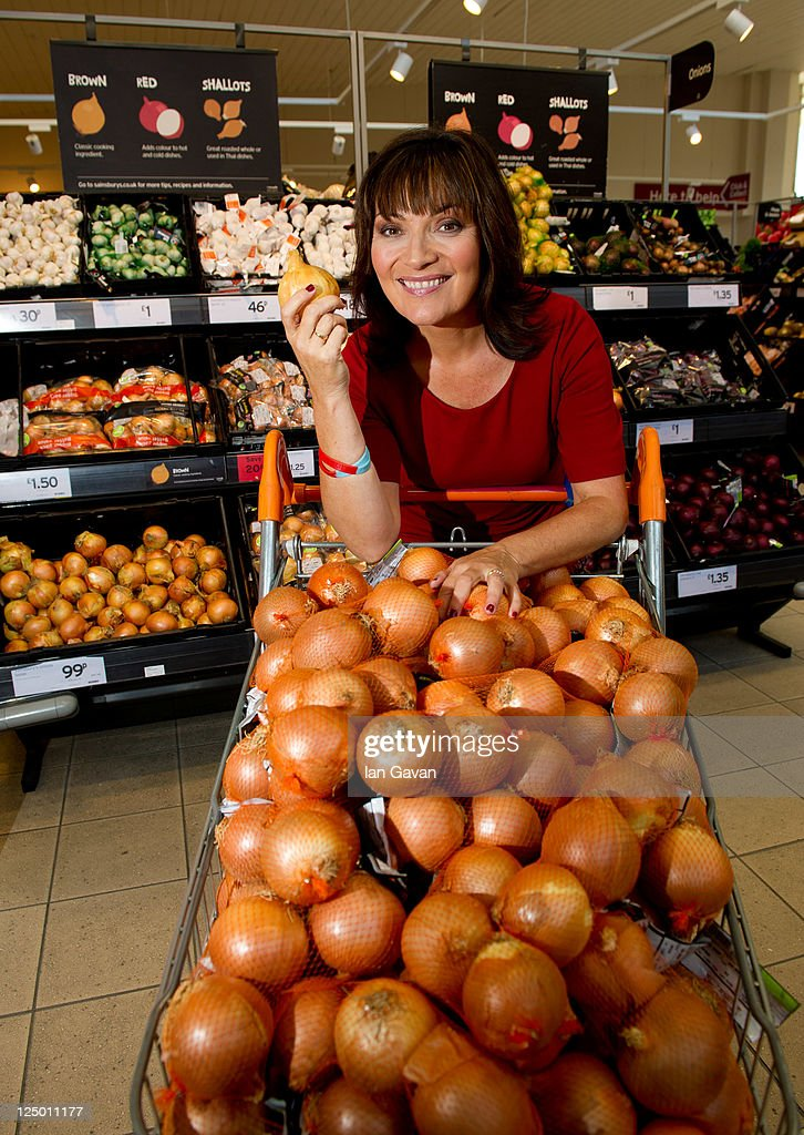 Lorraine Kelly poses with onions as she unveils that the humble onion gives the most pleasure per penny following new research from Sainsbury's 'Live...