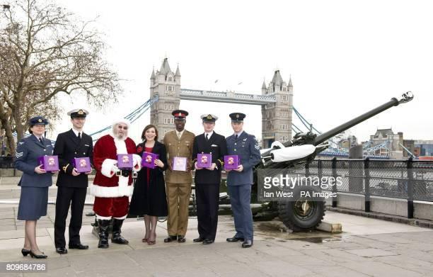 Lorraine Kelly stands Lorraine Kelly stands with Sgt Josephine Johnson Sub Lt Ross Wiltshire Santa Sgt Rayon Hammond Sub Lt Maxwell Cosby and Sgt...