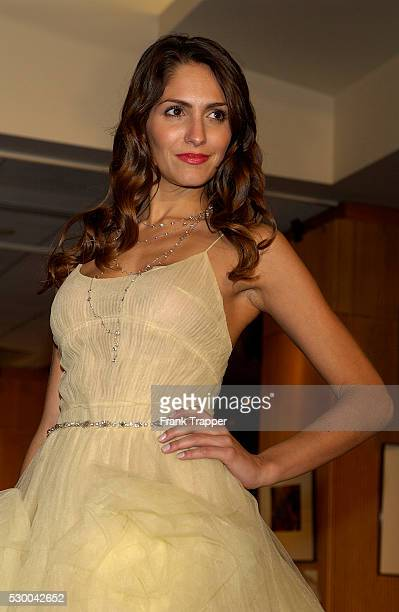Lorrayne wears a Reem Acra butter tulle ballet dress with Martin Katz platinum and diamond bead chain necklace 78 cts and vintage diamond drop...
