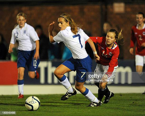 Lorrie Doze of England slips past Ida Rogndokken of Norway during the Women's U15 International Friendly match between England and Norway at the...