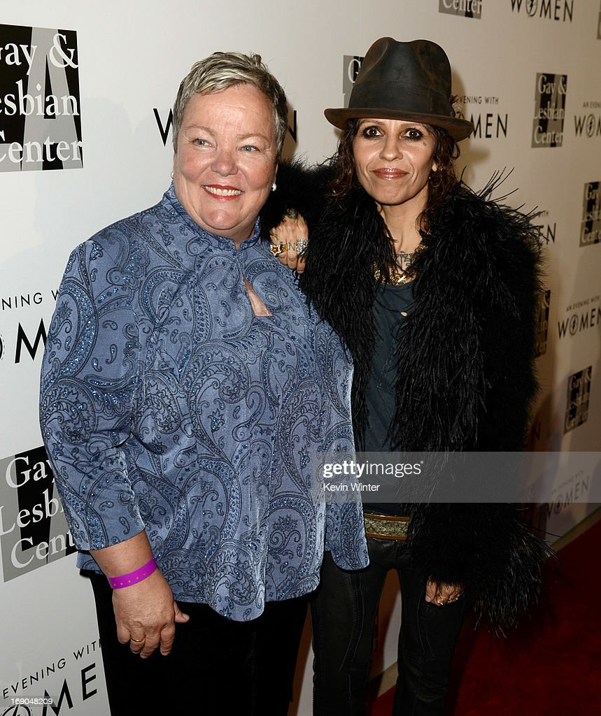 Lorrie Jean, CEO, L.A. Gay & Lesbian Center (L) and producer/musician Linda Perry arrive at An Evening With Women benefiting The L.A. Gay & Lesbian Center at the Beverly Hilton Hotel on May 18, 2013 in Beverly Hills, California.