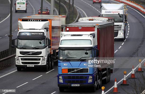 Lorries and other vehicles pass along the M4 motorway near Bristol on March 7 2012 in Bristol England Campaigners for fairer fuel prices were...