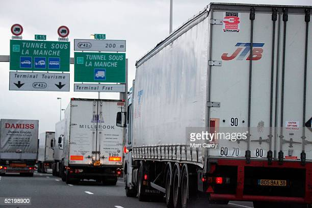 Lorries approach the French side of the Channel Tunnel as they head towards the UK February 14 2005 near Calais France Immigrants from countries as...