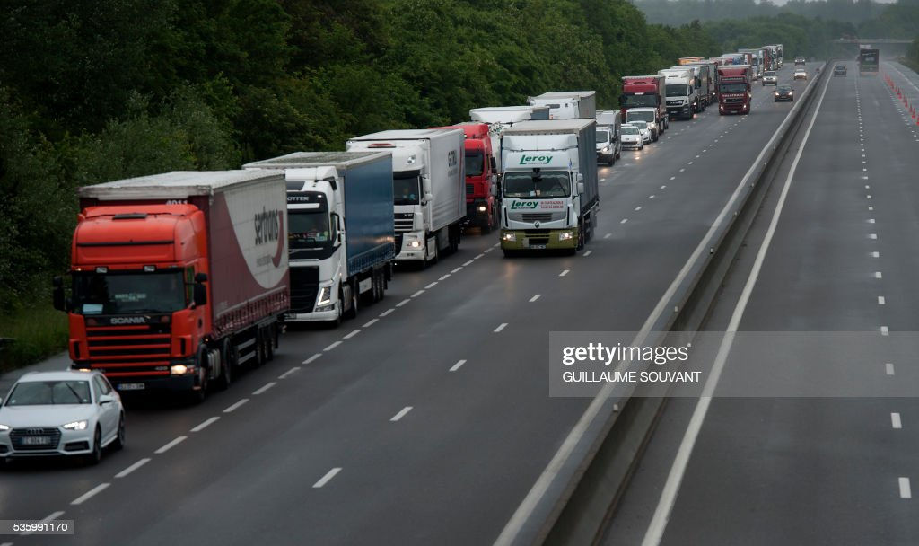 Lorries are blocked on the A10 highway on May 31, 2016 southern Orleans, following heavy rainfalls which have disrupted the traffic between Paris and Orleans. The Loiret department is under flood alert and France's weather agency Meteo France maintained today 18 departments under orange alert. SOUVANT
