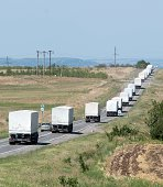 Lorries part of a Russian humanitarian convoy approach a checkpoint at the Ukrainian border some 30 km outside the town of KamenskShakhtinsky in the...