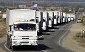 Lorries part of a Russian humanitarian convoy approach to the Ukrainian border at the DonetskIzvarino border checkpoint on September 19 2014 Russia...