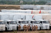 Lorries part of a Russian humanitarian convoy are parked not far from a checkpoint at the Ukrainian border some 30 km outside the town of...