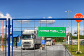 Trucks pass through the checkpoint of the customs logistics terminal.