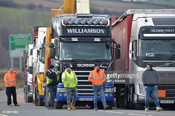 Lorries queue up after an overturned lorry caused the A1 road to be closed in both directions on February 16 2016 in Torness Scotland Two HGVs have...