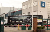 A lorry advertising a Vauxhall car drives through the Vauxhall plant in Luton after the parent company General Motors announced it is to sell...