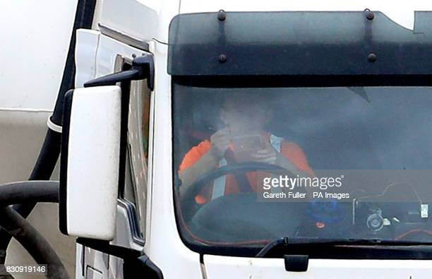 A lorry driver eats his lunch at the wheel as he drives along the M20 near Ashford Kent