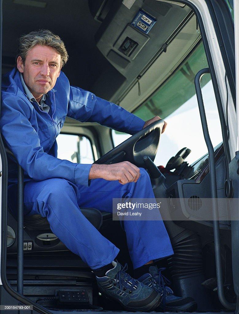 Lorry Driver In Cab View Through Open Door Portrait Stock