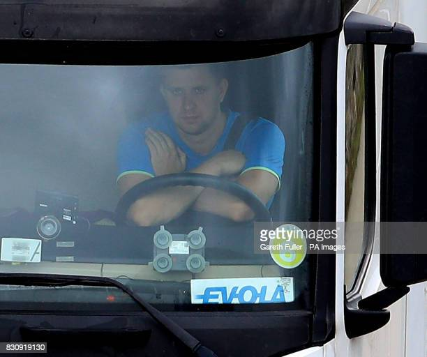 A lorry driver steers his vehicle using his elbows as he drives along the M20 near Ashford Kent