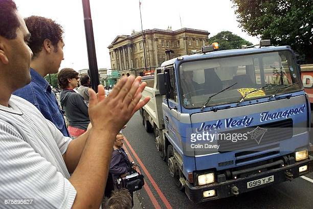 Lorry drivers are applauded on Park Lane in London during a fuel duty protest 13th September 2000