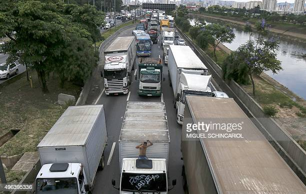Lorry drivers block the the Marginal Tiete highway in Sao Paulo Brazil on November 9 2015 during a national protest day demanding lower diesel oil...