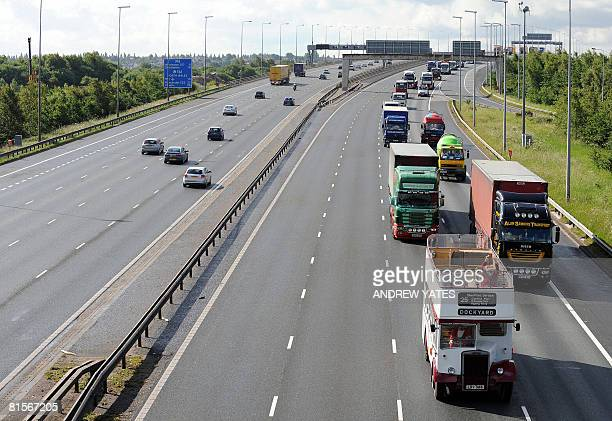 Lorry drivers drive in convoy along the M6 motorway in Warrington Cheshire northwest England in protest over fuel prices after diesel reached an...