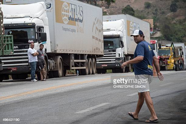 Lorry drivers on strike block the road in Joao Monlevade 80 km from Belo Horizonte Brazil on November 9 2015 during a national protest day demanding...