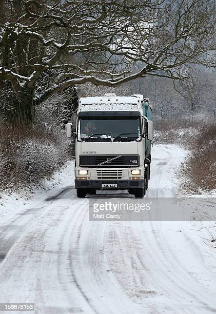 A lorry drives on a snow covered road near Holcombe on January 22 2013 in Somerset England Snow and ice is continuing to cause disruption to some...