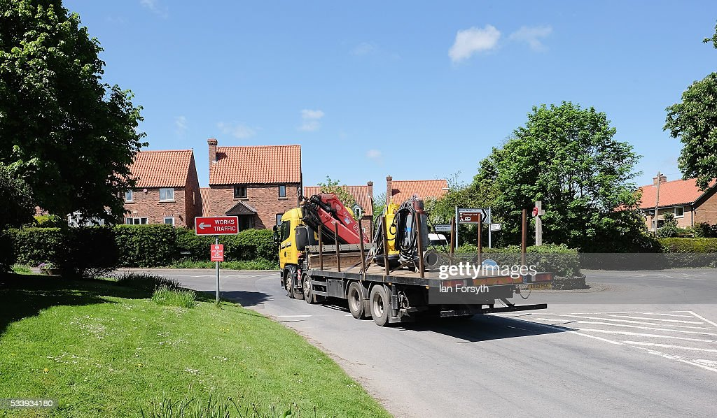 A lorry drives through the centre of Kirby Misperton on May 24, 2016 in Malton, England. North Yorkshire Planning and Regulatory Committee voted seven to four in favour of a planning application submitted by Third Energy to conduct fracking at the KM8 drilling site near the village. Hydraulic Fracturing, or fracking, is a technique designed to recover gas and oil from shale rock.