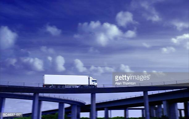 Lorry driving on motorway flyover (Digital Enhancement)