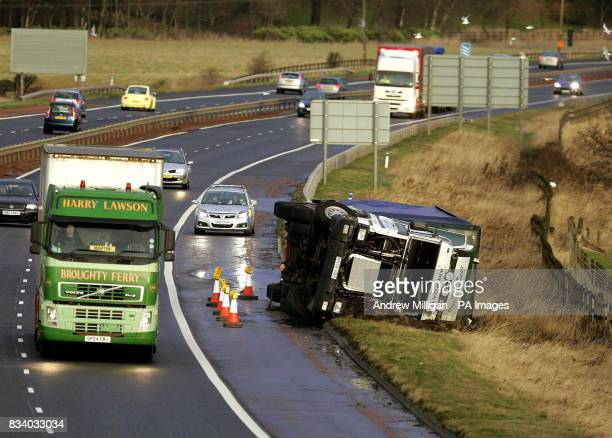 A lorry lies on its side blown over by the wind on the M9 near Stirling Galeforce winds of more than 75mph buffeted parts of Scotland and Northern...
