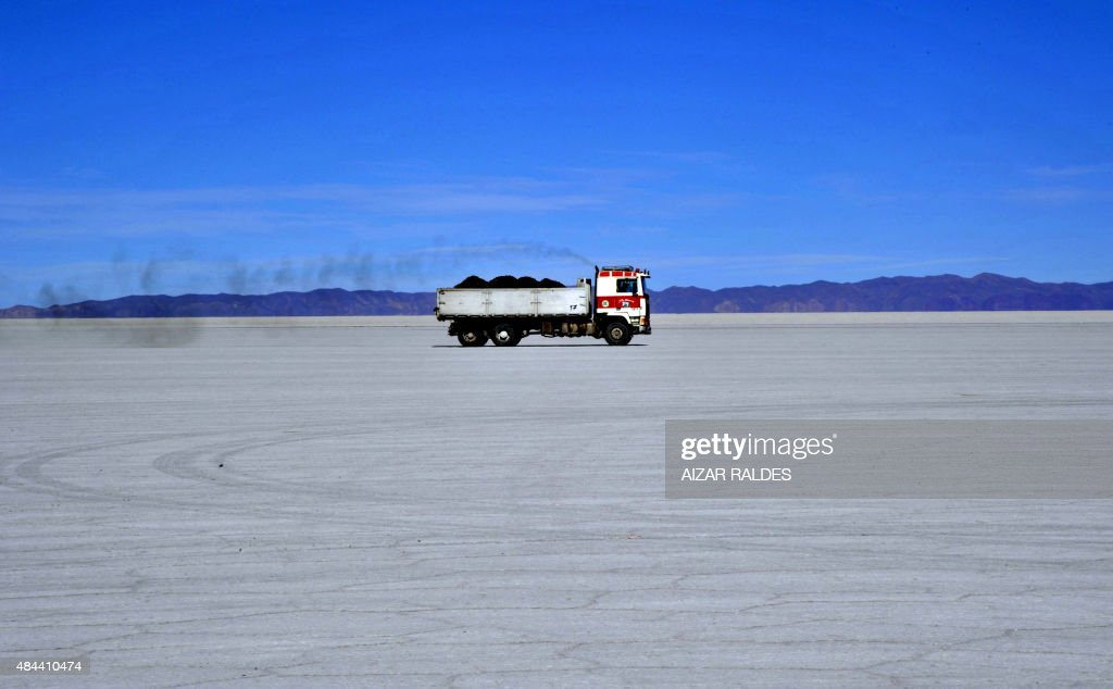 A lorry loaded with ore deives across the Uyuni salt pan south from La Paz on August 17 2015 The Bolivian government on Sunday signed a contract with...