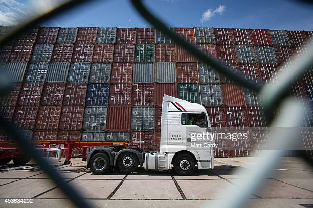 A lorry passes shipping containers close to the Border Force office at Southampton docks on August 13 2014 in Southampton England Border Force is the...