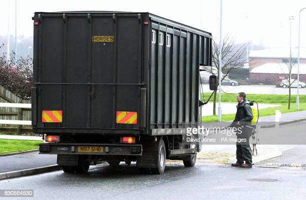 Lorry wheels are sprayed with disinfectant in an effort to prevent Foot and Mouth disease at the entrance to Wolverhampton Race Course