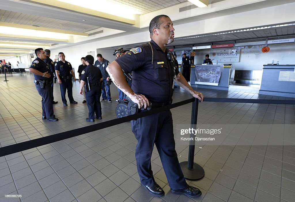 A Los Angeles Airport Police officer stands guard in between Terminll 3 and Terminal 2 as normal operations slowly return after a shooting incident at Los Angeles International Airport (LAX) November 1, 2013 in Los Angeles, California. A man identified as Paul Ciancia reportedly pulled out an assault rifle in Terminal 3 of the airport and shot his way through security, killing one Transportation Security Administration (TSA) worker and wounding several others before being shot himself.
