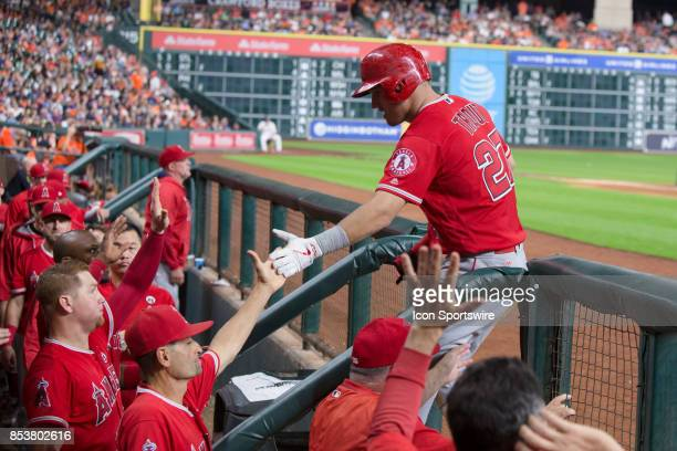 Los Angeles Angels center fielder Mike Trout shakes hands after scoring in the fifth inning during an MLB game between the Houston Astros and the Los...