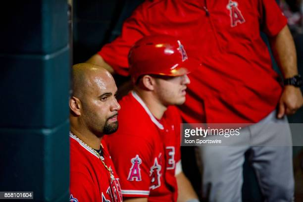 Los Angeles Angels designated hitter Albert Pujols and Los Angeles Angels center fielder Mike Trout in the dugout in the seventh inning during an MLB...