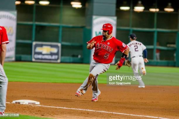 Los Angeles Angels designated hitter Albert Pujols reaches third base on a Houston Astros third baseman Alex Bregman fielding error in the seventh...