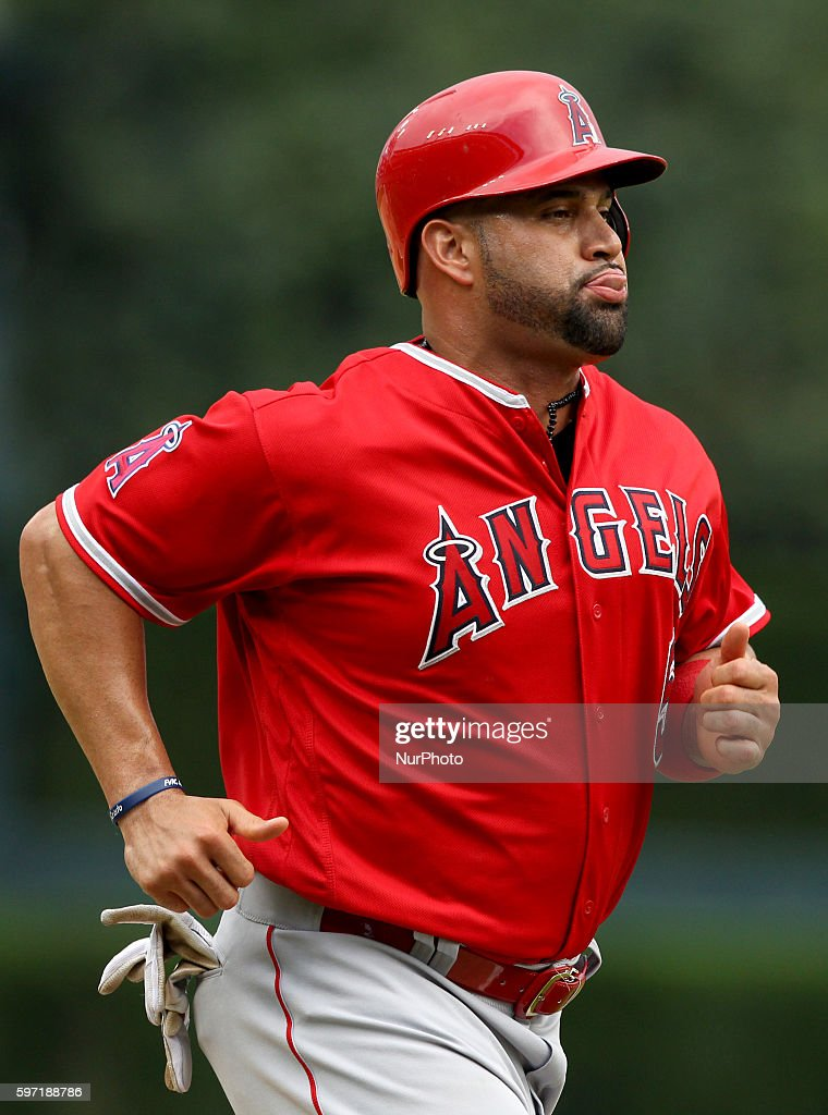 Los Angeles Angels designated hitter Albert Pujols scores a run on the sixth inning of a baseball game against the Detroit Tigers in Detroit Michigan...