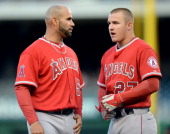 Los Angeles Angels first baseman Albert Pujols and Angels center fielder Mike Trout have a quick chat after Pujols was doubled out at second base to...