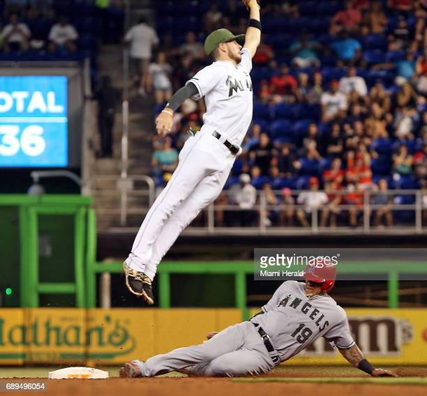 Los Angeles Angels' Jefry Marte slides safely into second base as the Miami Marlins' JT Riddle tries to grab an overthrown ball in the third inning...