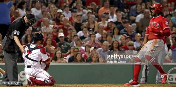Los Angeles Angels left fielder Cameron Maybin walks home on a Balk call on Boston Red Sox pitcher Fernando Abad not pictured as Boston Red Sox...