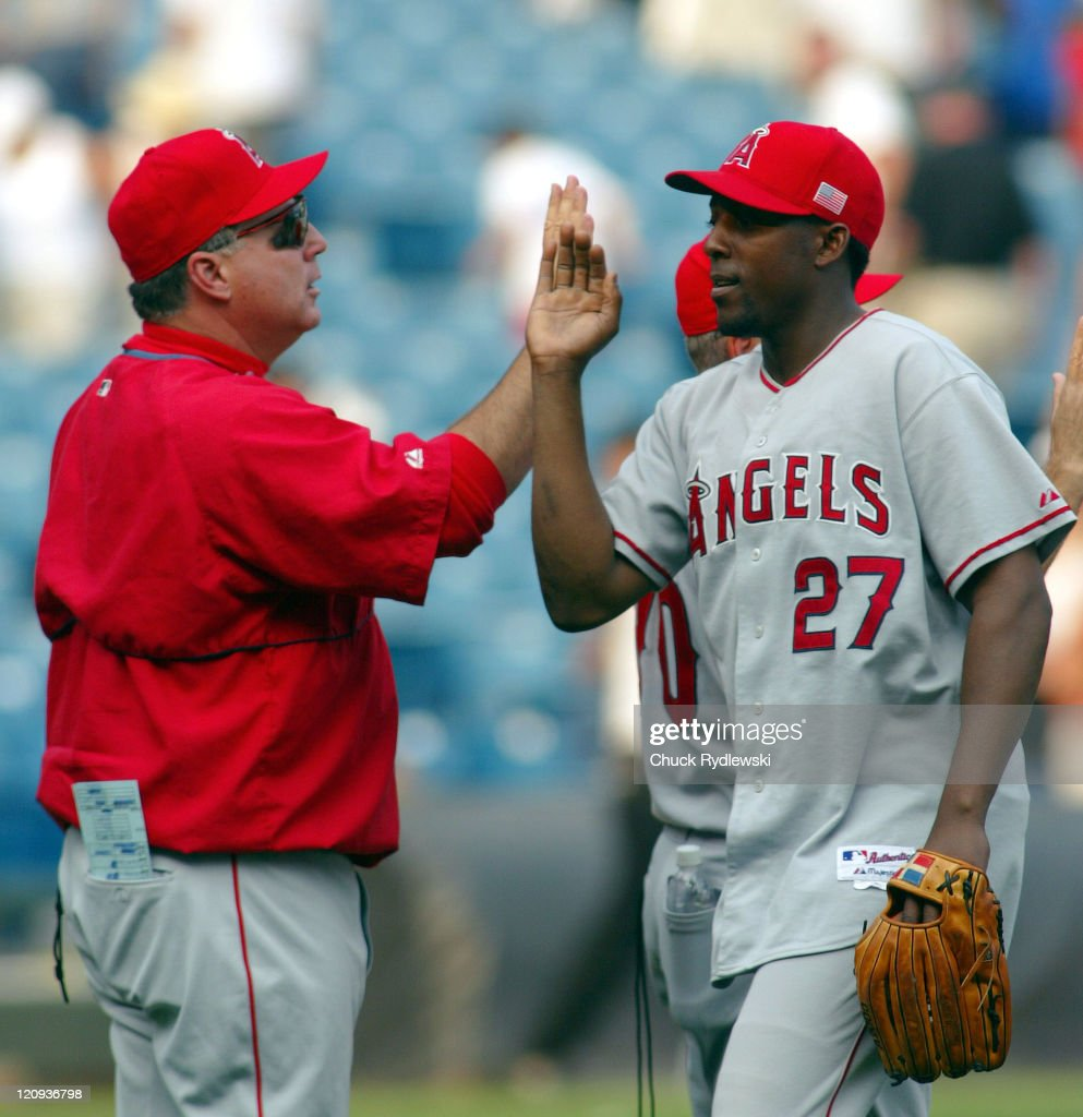 Los Angeles Angels' Manager, <a gi-track='captionPersonalityLinkClicked' href=/galleries/search?phrase=Mike+Scioscia&family=editorial&specificpeople=206319 ng-click='$event.stopPropagation()'>Mike Scioscia</a> and <a gi-track='captionPersonalityLinkClicked' href=/galleries/search?phrase=Vladimir+Guerrero&family=editorial&specificpeople=171986 ng-click='$event.stopPropagation()'>Vladimir Guerrero</a>, celebrate their three game sweep over the White Sox September 11, 2005 at U.S. Cellular Field in Chicago, Illinois. The Angels would win 6-1.