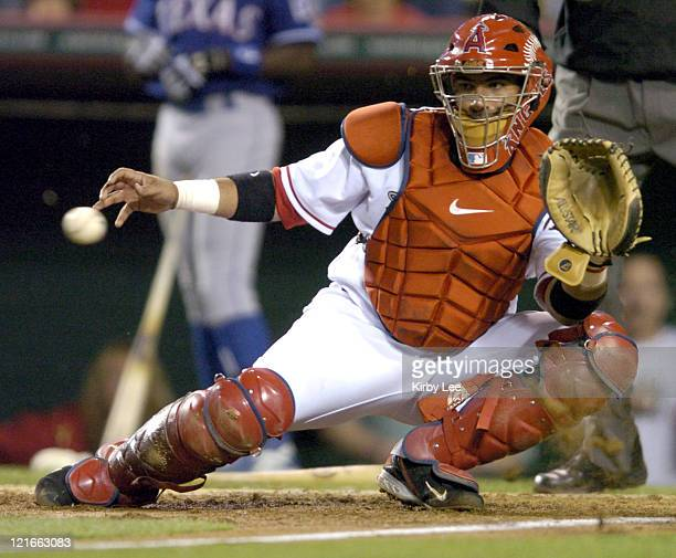 Los Angeles Angels of Anaheim catcher Bengie Molina catches a relay throw from Orlando Cabrera to tage out Gary Matthews Jr of the Texas Rangers in...