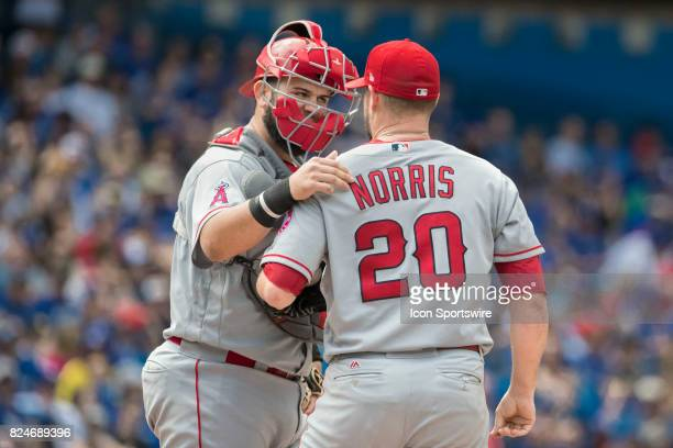 Los Angeles Angels of Anaheim Catcher Martin Maldonado gives encouragement to Pitcher Bud Norris during the regular season MLB game between the Los...