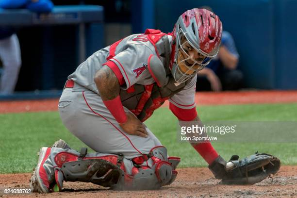 Los Angeles Angels of Anaheim Catcher Martin Maldonado glares down the first base line during the regular season MLB game between the Los Angeles...