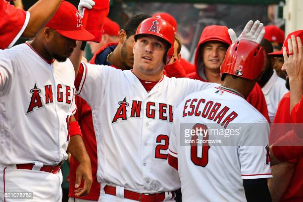 Los Angeles Angels of Anaheim Center field Mike Trout gets high fives after scoring a run during an MLB game between the Boston Red Sox and the Los...