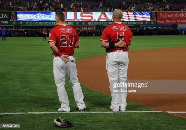 Los Angeles Angels of Anaheim center fielder Mike Trout and designated hitter Albert Pujols on the field during the national anthem before an MLB...