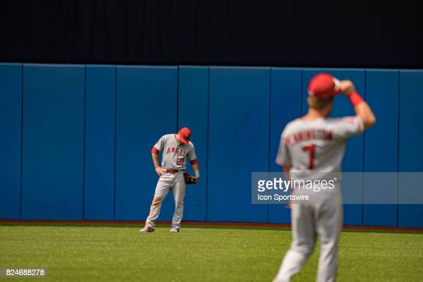 Los Angeles Angels of Anaheim Center fielder Mike Trout and Los Angeles Angels of Anaheim Infielder Cliff Pennington during a lull in the action in...