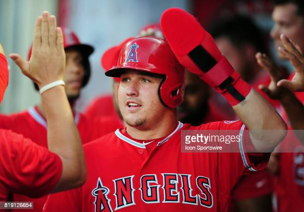 Los Angeles Angels of Anaheim center fielder Mike Trout in the dugout after scoring on a sacrifice fly during the first inning of a game against the...