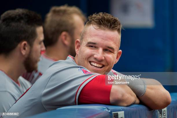 Los Angeles Angels of Anaheim Center fielder Mike Trout smiles in the dugout during the regular season MLB game between the Los Angeles Angels of...