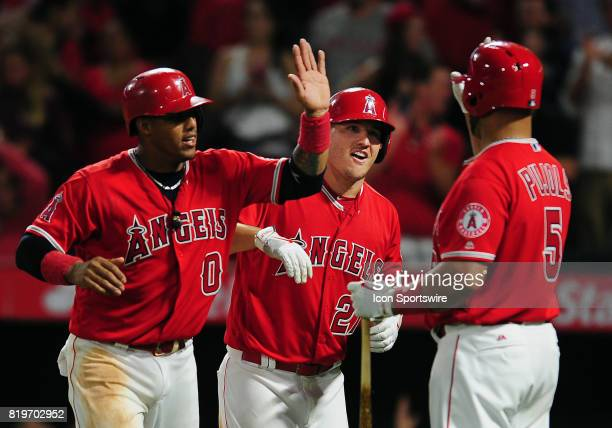 Los Angeles Angels of Anaheim center fielder Mike Trout with Yunel Escobar and Albert Pujols after Trout hit a two run home run in the seventh inning...