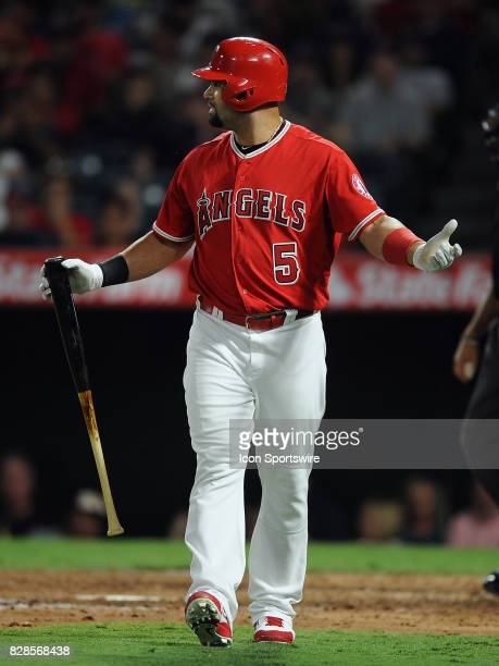 Los Angeles Angels of Anaheim designated hitter Albert Pujols looks down towards first base with arms raised after being called out swinging by the...