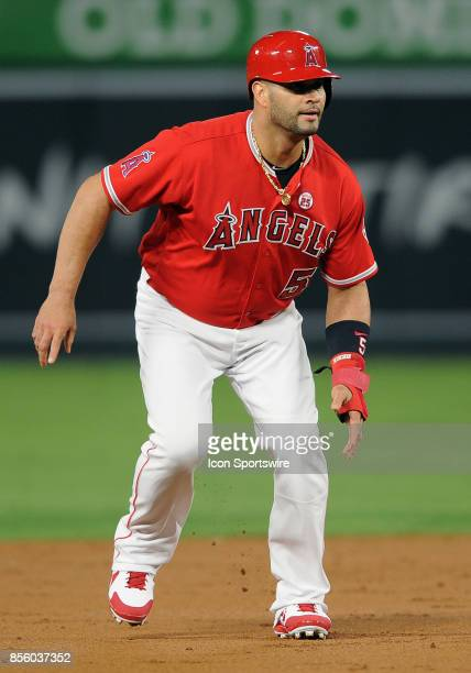 Los Angeles Angels of Anaheim designated hitter Albert Pujols takes a lead off second base during the first inning of a game against the Seattle...